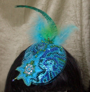 Turquoise Peacock Fascinator - On Head
